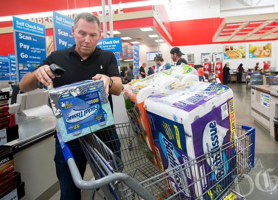 NWA Democrat-Gazette/JASON IVESTER<br /> Scott Leach of Rogers scans items at a self check out station Tuesday, April 18, 2017, at Sam's Club in Bentonville. Sam's Club is expanding private label of Member's Mark items.