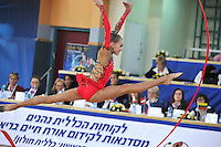 "Elizaveta Nazarenkova of Russia performs with ribbon on way to winning seniors group ""B"" All Around at 2011 Holon Grand Prix, Israel on March 5, 2011.  (Photo by Tom Theobald)."
