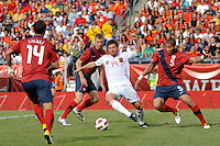 Xabi Alonso (14) of Spain is marked by Oguchi Onyewu (5) of the United States. The men's national team of Spain (ESP) defeated the United States (USA) 4-0 during a International friendly at Gillette Stadium in Foxborough, MA, on June 04, 2011.
