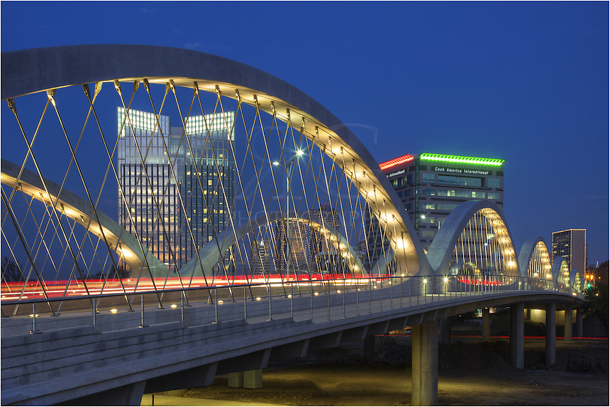 In the blue light after sunset. the Seventh Street Bridge in Fort Worth connects the downtown area with the cultural district for both cars and pedestrians. In the distance is the Ft. Worth skyline.