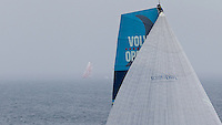 NEW ZEALAND. 11th March 2012. Volvo Ocean Race Leg 4. Leg finish Auckland. Team Telefonica with Camper with Emirates Team NZ in the distance.