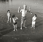 Grandfather being strongman for grandchildren. Raystown Lake, PA. 1976