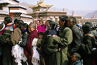 Some tibetan pilgrims queuing up to see the Buddha Maitreya -the Buddha of the future- who is one of the most popular deities in Tibet because he symbolizes the hope of a better life after the reincarnation. The pilgrims often make a donation of a katag (white skarf ) and give some banknotes, in the monastery of Labrang during the ceremonies of Monlam Chenmo (The Great Prayer) at the beggining of the tibetan year. They come from all the countries around, often after many days of travels. Labrang, province of Gansu, China, March 05 2007.