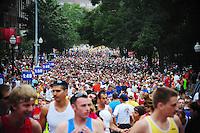 Runners fill Langdon Street at the start of the Madison Mini-Marathon on Saturday in Madison, Wisconsin