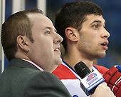 Jimmy Connelly waits to interview Pendenza. - The University of Massachusetts Lowell River Hawks defeated the visiting American International College Yellow Jackets 6-1 on Tuesday, December 3, 2013, at Tsongas Arena in Lowell, Massachusetts.