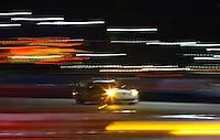 Night time action at the Rolex 24 at Daytona , Daytona International Speedway, Daytona Beach, FL, January 2009.  )Photo by Brian Cleary)