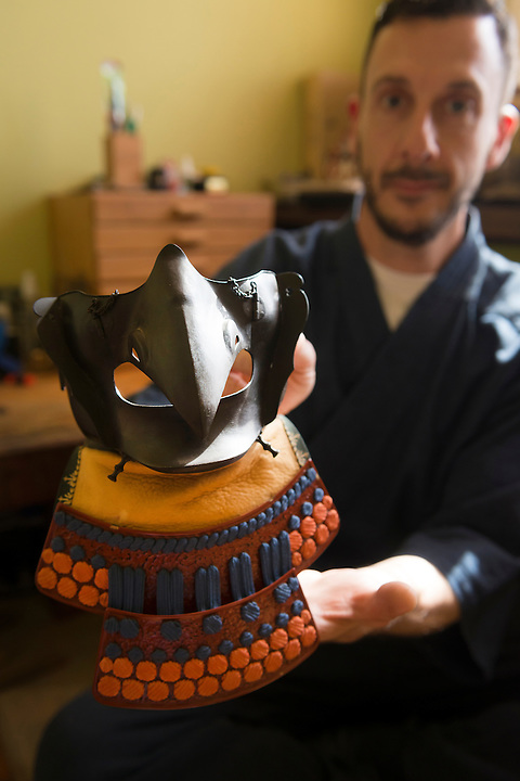 Soanes holds a menpo mask. Robert Soanes Japanese Armour and Antiques Restorer, Brighton, UK, May 6, 2016. Craftsman Robert Soanes specializes in the restoration and conservation of samurai armour, swords and other Japanese fine art. He lives and works in the English seaside resort of Brighton.