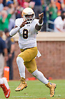 Sep 12, 2015; Irish quarterback Malik Zaire (8) celebrates after throwing a touchdown pass in the third quarter against Virginia. (Photo by Matt Cashore)