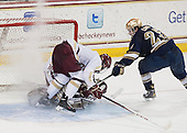 Steven Santini (BC - 6), Kevin Lind (ND - 25) - The visiting University of Notre Dame Fighting Irish defeated the Boston College Eagles 7-2 on Friday, March 14, 2014, in the first game of their Hockey East quarterfinals matchup at Kelley Rink in Conte Forum in Chestnut Hill, Massachusetts.