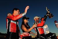Oct. 30, 2011; Las Vegas, NV, USA: NHRA pro stock motorcycle rider Eddie Krawiec (right) celebrates alongside teammate Andrew Hines after winning the Big O Tires Nationals at The Strip at Las Vegas Motor Speedway. Mandatory Credit: Mark J. Rebilas-