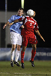 10 November 2010: NC State's Farouk Bseiso (5) and UNC's Drew McKinney (23). The University of North Carolina Tar Heels the North Carolina State University Wolfpack at Koka Booth Stadium at WakeMed Soccer Park in Cary, North Carolina in an ACC Men's Soccer Tournament Quarterfinal game.