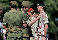 Lt.Gen. Brovold pins a medal on a soldier. Norwegian soldiers receive medals after a tour with International Security Assistance Force (ISAF), Afghanistan. Prime Minister Jens Stoltenberg and Defense Minister Grete Faremo attended the ceremony held at Akershus Castle in Oslo.
