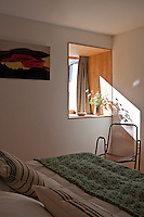 Each of the chalet bedrooms is simply furnished with colourful bed covers and cushions