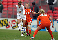 COLLEGE PARK, MD - OCTOBER 28, 2012:  Becky Kaplan (19) of the University of Maryland shoots as Tara Schwitter (24) of Miam moves ini during an ACC  women's tournament 1st. round match at Ludwig Field in College Park, MD. on October 28. Maryland won 2-1 on a golden goal in extra time.