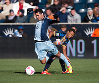 Soony Saad (22) of Sporting Kansas City is fouled by Kleberson (19) of the Philadelphia Union during a Major League Soccer game at PPL Park in Chester, PA. Sporting Kansas City defeated the Philadelphia Union, 2-1.