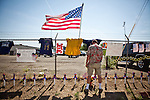 Dave Anderson pays his respects at a makeshift memorial outside Fire Station 7 in Prescott, Arizona, July 2, 2013, the home of the 19 Granite Mountain Hotshots who perished in the Yarnell Fire Sunday.
