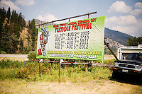 A sign advertising the Testicle Festival and the Rock Creek Lodge stands outside Clinton, MT, alongside I-90.  The Rock Creek Lodge in Clinton, MT, has hosted the annual Testicle Festival since the early 1980s.  The four day festival and party revolves around the consumption of so-called Rocky Mountain Oysters, which are deep-fried bull testicles.