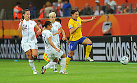 Lauren Cheney, Alex Krieger and Megan Rapinoe (left to right) of team USA and Therese Sjogran of team Sweden during the FIFA Women's World Cup at the FIFA Stadium in Wolfsburg, Germany on July 6thd, 2011.