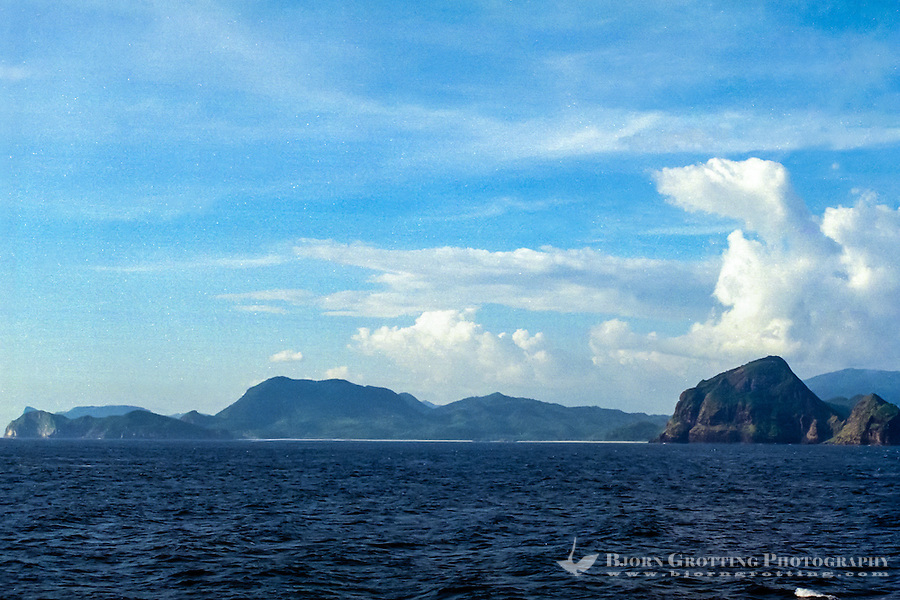 West Nusa Tenggara, Sumbawa. South coast of Sumbawa, on the western part. Lots of mountains and cliffs here, and inbetween long, white beaches with crystal clear water.