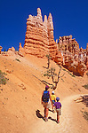 Family hiking on the Queen's Garden Trail, Bryce Canyon National Park, Utah USA