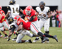 The Georgia Bulldogs beat the App State Mountaineers 45-6 in their homecoming game.  After a close first half, UGA scored 31 unanswered points in the second half.  Appalachian State Mountaineers quarterback Kameron Bryant (5), Georgia Bulldogs linebacker James DeLoach (89)