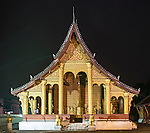 A shot of the illuminated main building of Wat Sensoukharam, Luang Prabang, taken in early morning before sunrise.