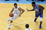 07 March 2015: North Carolina's Joel Berry II (2) and Duke's Amile Jefferson (21). The University of North Carolina Tar Heels played the Duke University Blue Devils in an NCAA Division I Men's basketball game at the Dean E. Smith Center in Chapel Hill, North Carolina. Duke won the game 84-77.