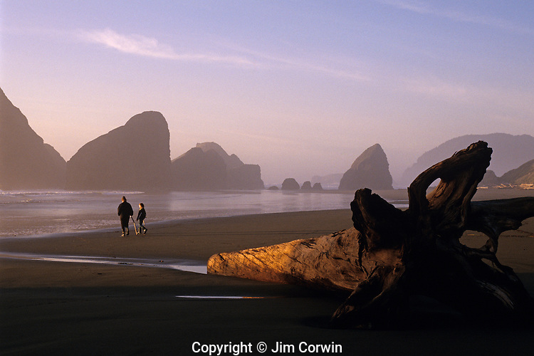 Cape Sebastian State Park Southern Oregon Coast mother daughter at sunset with rock formations at low tide with walking canes watching sunset Oregon State USA
