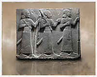 Picture & image of a Neo-Hittite orthostat of 3 warriors from the legend of Gilgamesh from Karkamis,, Turkey. Museum of Anatolian Civilisations, Ankara. The warrior on the far left holds a spear in one hand and the branch of a tree in the other. The middle warrior has a clenched fist an carries an impliment over his shoulder. The warrior on the far right carries a saff. All 3 are wearing swords. 2