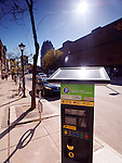 Solar energy powered parking meter on a street of Ottawa, Ontario, Canada.