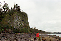 Haida Gwaii (Queen Charlotte Islands), Northern BC, British Columbia, Canada - Hiker exploring Tidal Pools at Tow Hill and North Beach along McIntyre Bay, Naikoon Provincial Park, Graham Island (Model Released) - Agate Beach in Distance