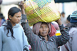 A woman walks through a market in the Cambodian village of Maung Rossey.