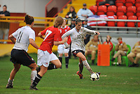 Carli Lloyd mounts an attack vs. Norway.  The USA defeated Norway 2-1 at Olhao Stadium on February 26, 2010 at the Algarve Cup.
