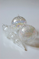 A trio of glass baubles of different textures