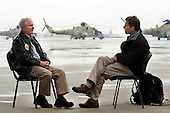 Kabul, Afghanistan - December 9, 2009 -- United States Secretary of Defense Robert M. Gates talks with CBS correspondent Terry McCarthy during an interview in Kabul, Afghanistan, Wednesday, December 9, 2009. Secretary Gates is on his first trip back to southwest asia after U.S. President Barack Obama agreed to send an additional 30,000 troops to Afghanistan. .Mandatory Credit: Jerry Morrison - DoD via CNP