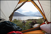 BNPS.co.uk (01202 558833)<br /> Pic: WildGuideScotland/BNPS<br /> <br /> Spectacular camping at Badrallach in Gairloch.<br /> <br /> Scotland's stunning unspoiled scenery is being shown in a whole new light in a book that reveals the hidden gems off the beaten track north of the border.<br /> <br /> Three young photographers travelled the width and breadth of Scotland and snapped 750 picturesque places which include shimmering lochs, ancient forests, lost ruins, hidden beaches, secret islands, dramatic cliffs, tiny glens and mysterious grottoes. <br /> <br /> Friends Kimberley Grant, David Cooper and Richard Gaston, all in their late 20s, have spent the past two years exploring lesser known idyllic spots which they are keen to bring to a wider audience.