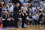 18 February 2017: Virginia head coach Tony Bennett (left) talks to referee Tim Clougherty. The University of North Carolina Tar Heels hosted the University of Virginia Cavaliers at the Dean E. Smith Center in Chapel Hill, North Carolina in a 2016-17 Division I Men's Basketball game. UNC won the game 65-41.