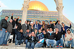 Ahmad Khalaf with friends pose for a picture outside al-Aqsa mosque after he was released from an Israeli prison, in Jerusalem's old city December 31, 2013. Israel freed 26 Palestinian prisoners on Tuesday, days before U.S. Secretary of State John Kerry was due back in the Middle East to press the two sides to agree a framework peace deal. Photo by Saeed Qaq