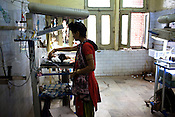 A young woman is seen with her premature baby who is kept under observation in an incubator in the pediatrics section of Maharani Laxmibai Medical College in Jhansi, Uttar Pradesh, India. The Indian government spends $1.4 billion a year - on programs that include weighing newborn babies, counseling mothers on healthy eating and supplementing meals, but none of this is yeilding results. According to UNICEF, some 48% of Indian children, or 61 million kids, remain malnourished, the clinical condition of being so undernourished that their physical and mental growth are stunted. Photo: Sanjit Das/Panos for The Wall Street Journal.Slug: IMALNUT