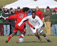 Amherst forward Robert Gooden (11) attempts to control the ball as St. Lawrence defender Seyefe Brouk (12) closely defends. NCAA Division III Sectionals. In double-overtime, Amherst College (white) defeated St. Lawrence University (red), 2-1, on Hitchcock Field at Amherst College on November 23, 2013.