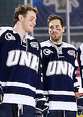 Connor Hardowa (UNH - 2), Austin Block (UNH - 3) - The University of Maine Black Bears defeated the University of New Hampshire Wildcats 5-4 in overtime on Saturday, January 7, 2012, at Fenway Park in Boston, Massachusetts.