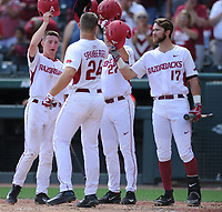 NWA Democrat-Gazette/ANDY SHUPE<br />Arkansas first baseman Chad Spanberger (24) is congratulated at the plate by shortstop Jax Biggers (from left), designated hitter Evan Lee and left fielder Luke Bonfield against Georgia Saturday, April 15, 2017, after hitting a three-run home run during the second inning at Baum Stadium in Fayetteville. Visit nwadg.com/photos to see more photographs from the game.
