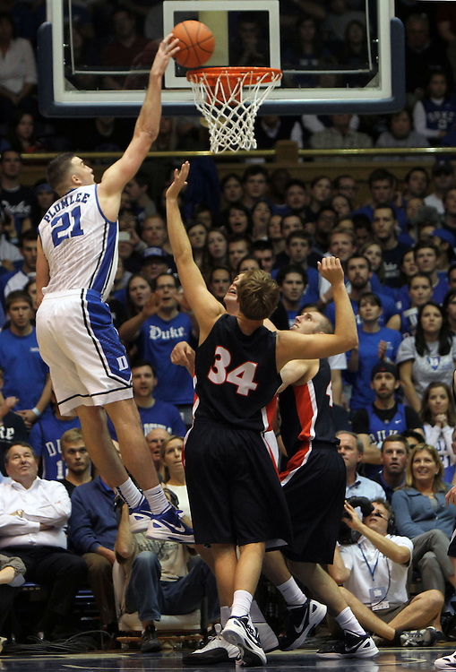 Miles Plumlee dunks over Belmont. Duke beat Belmont 77-76 on Friday, November 11, 2011 at Cameron Indoor Stadium in Durham, NC. It was win number 901 for Duke head coach Mike Krzyzewski, making him only two wins away from the NCAA DivisionI all-time win record. Photo by Al Drago.