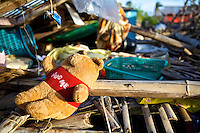 A teddy bear is one of the only possessions Febe from Panagatan, Caluya still has after Typhoon Yolanda (Haiyan) passed by the island.