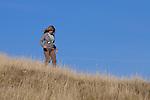 Woman hiking at Cronan Ranch Regional Trails Park, Pilot Hill, California