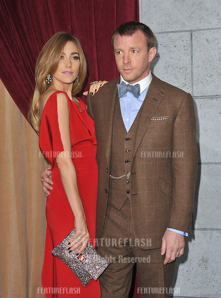 """Director Guy Ritchie & Jacqui Ainsley at the Los Angeles premiere of his new movie """"Sherlock Holmes: A Game of Shadows"""" at the Village Theatre, Westwood..December 6, 2011  Los Angeles, CA.Picture: Paul Smith / Featureflash"""