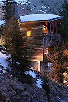 The exterior of the chalet at dusk