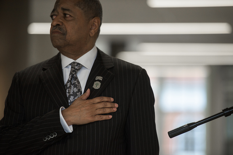 President Roderick McDavis stands for the singing of the National Anthem during the ribbon cutting ceremony for the Gladys W. and David H. Patton College of Education's newly renovated McCracken Hall held on January 27, 2017.