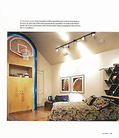 The raised ceiling made it possible to fulfill a basketball lover's wish to shoot hoops in his room.<br /> <br /> An extra layer of felt batts soundproofs the wood floor. The under-hoop cabinet houses the TV and the sound system, while rickrack shelves display autographed balls function as a headboard.