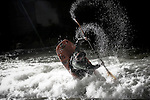Kayakers practice at night in hole three of the Reno Whitewater park just before the Reno Riverfestival. May 2008...**No Model release on this image***